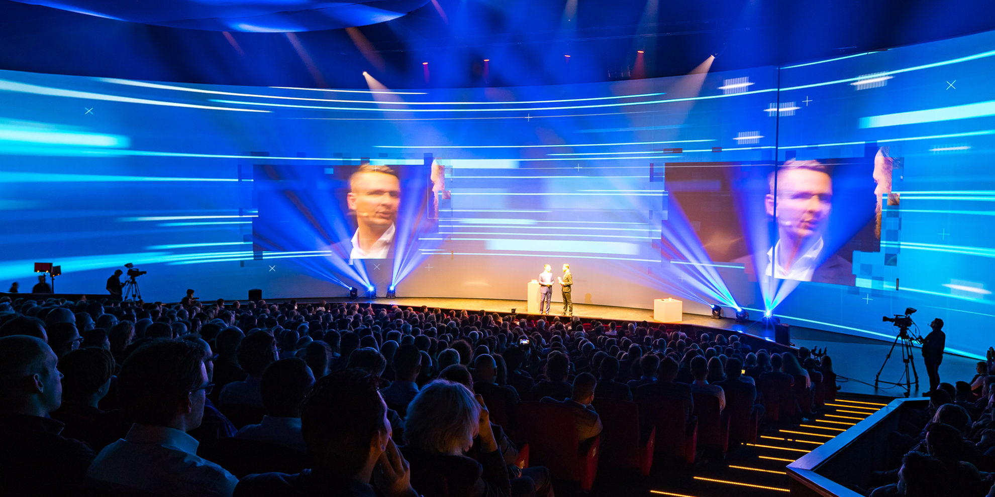 presentation in a large venue with 180 degrees screen